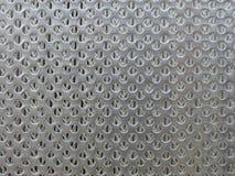 Fondo circolare multiplo della maglia metallica del foro fotografia stock libera da diritti