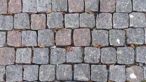 Fondo cobblestoned del pavimento del granito imagen de archivo