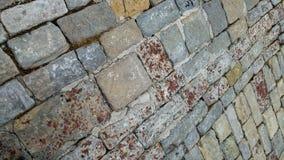 Fondo cobblestoned del pavimento del granito Textura de piedra del pavimento fotos de archivo libres de regalías