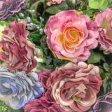 Fondo color de rosa artificial de la flor para su diseño fotos de archivo