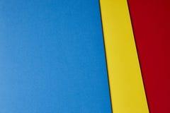 Fondo colorato dei cartoni nel tono rosso giallo blu Copi Spac fotografia stock
