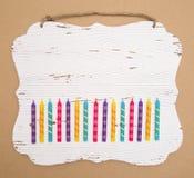 Fondo coloreado arco iris de la vela del cumpleaños Foto de archivo libre de regalías