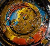 Fondo colorido abstracto de las burbujas que se asemeja a los planetas en el universo imagen de archivo libre de regalías