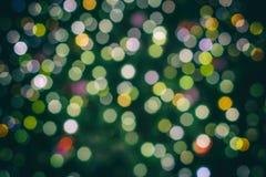 Fondo colorido de la Navidad de luces coloridas como plantilla foto de archivo