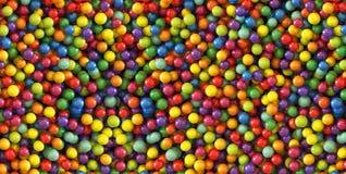 Fondo colorido de las bolas de la gragea Diseño del modelo de la foto para la bandera, cartel, aviador, tarjeta, postal, cubierta Foto de archivo libre de regalías