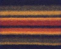 Fondo colorido de las materias textiles Foto de archivo