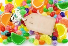 Fondo colorido del caramelo con la etiqueta Imagen de archivo