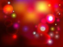 Fondo colorido del día de fiesta con las luces y los spackles Foto de archivo libre de regalías