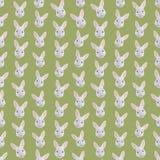 Fondo colorido inconsútil hecho de jefes de conejos en d plana Fotos de archivo