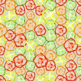 Fondo colorido inconsútil hecho de rebanadas de pimienta en el de plano Foto de archivo libre de regalías