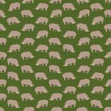 Fondo colorido inconsútil hecho de rinocerontes en diseño plano Imágenes de archivo libres de regalías