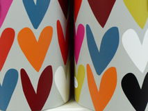 Fondo Colourful delle tazze dei cuori dei cuori variopinti Immagine Stock
