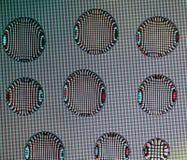 Fondo con i cerchi luccicanti luminosi delle goccioline di acqua con Fotografie Stock