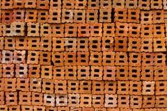 Fondo con i fori del mattone. Fotografia Stock