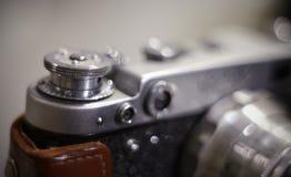 Fondo con la macchina da presa analogica d'annata Fotografia Stock