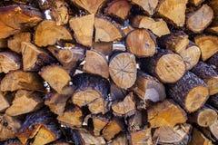 Fondo con la pila di legna da ardere Immagini Stock