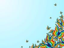 Fondo con las mariposas del arco iris en la esquina de la imagen Imagen de archivo libre de regalías