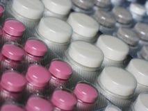 Fondo con las píldoras coloreadas al azar Fotografía de archivo