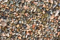 Fondo con las piedras del mar Imagen de archivo