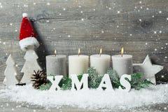 Fondo con le candele ed i fiocchi di neve per il Natale Fotografia Stock