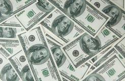 Fondo con los billetes de dólar del americano ciento del dinero Imagen de archivo libre de regalías