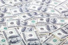 Fondo con los billetes de dólar del americano ciento del dinero Foto de archivo