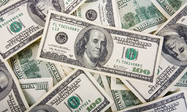 Fondo con los billetes de dólar del americano ciento del dinero Imagen de archivo