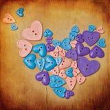 Fondo con los botones de la dimensión de una variable del corazón Fotografía de archivo libre de regalías