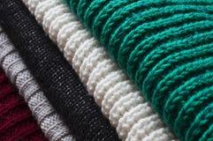 Fondo con los suéteres hechos punto Foto de archivo