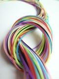 Fondo con un bello nodo delle corde multicolori Immagine Stock