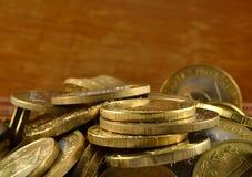 Fondo de las monedas de oro Foto de archivo libre de regalías