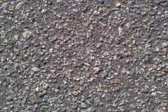 Fondo concreto grigio con le piccole pietre Fotografia Stock Libera da Diritti