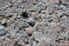 Fondo concreto grigio con le pietre Struttura o fondo Fotografie Stock Libere da Diritti