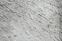 Fondo concreto sulla parete di pietra rivestita - contesto strutturato grigio Fotografia Stock