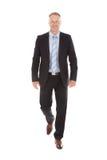 Fondo confiado de Walking Over White del hombre de negocios imagen de archivo libre de regalías