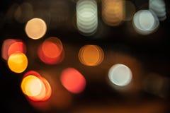 Fondo confuso della luce della città nella vita notturna Estratto e w immagini stock libere da diritti