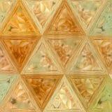Fondo continuo de los triángulos de oro en naranja y amarillo imagen de archivo libre de regalías