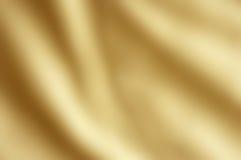 Fondo coprente del raso dell'oro Fotografie Stock Libere da Diritti