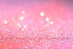 Fondo coralino de la celebración de días festivos del bokeh de la luz del brillo del rosa del extracto fotografía de archivo libre de regalías