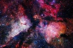Fondo cosmico della galassia con le nebulose, lo stardust e le stelle luminose illustrazione di stock