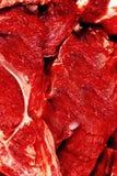 Fondo crudo de los filetes de carne de vaca foto de archivo