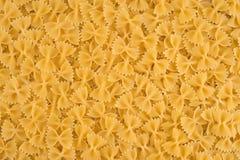 Fondo crudo dell'alimento della pasta di Farfalle dell'italiano Fotografia Stock