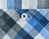Fondo a cuadros de la textura de la ropa Imagenes de archivo