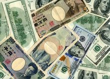 Fondo Dólares y yenes imágenes de archivo libres de regalías