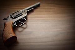 Fondo d'annata del revolver Immagini Stock