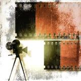 Fondo d'annata della striscia di pellicola e vecchia cinepresa Fotografia Stock Libera da Diritti