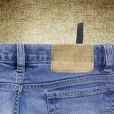 Fondo da un tessuto e da una carta da parati dei jeans Fotografia Stock