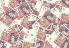 Fondo dalle banconote di 50 di sterlina, concetto finanziario Economia dei ricchi di successo di concetto Immagine Stock