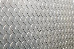 Fondo de aluminio brillante con la pieza diagonal del alivio Imagen de archivo libre de regalías