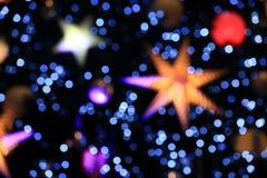 Fondo de Bokeh de la luz de la Navidad Imagenes de archivo